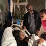 Black couple and their black doula at the birth of their baby
